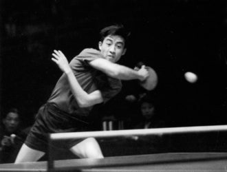 Zhuang Zedong playing at the twenty-sixth World Table Tennis Championships, in which he won the men's singles title, Beijing, 1961