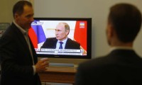 Ukrainian members of parliament watching Russian President Vladimir Putin's press conference, March 4, 2014