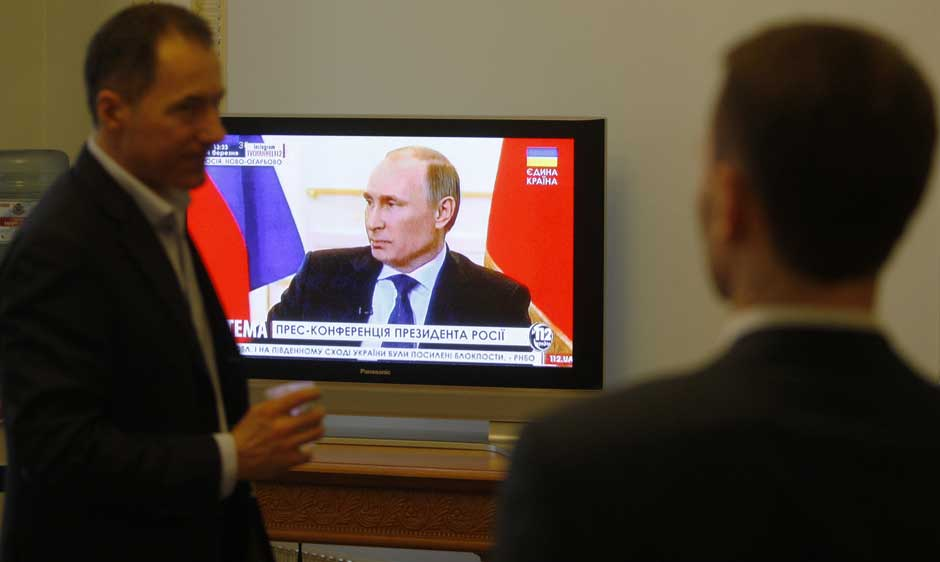 Ukrainian members of parliament watching Russian President Vladimir Putin's press conference, March 4, 2014