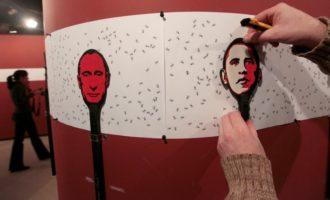 A museum installation by Russian artist Vasily Slonov, with flyswatters depicting Vladimir Putin and Barack Obama, Krasnoyarsk, Russia, October 25, 2012