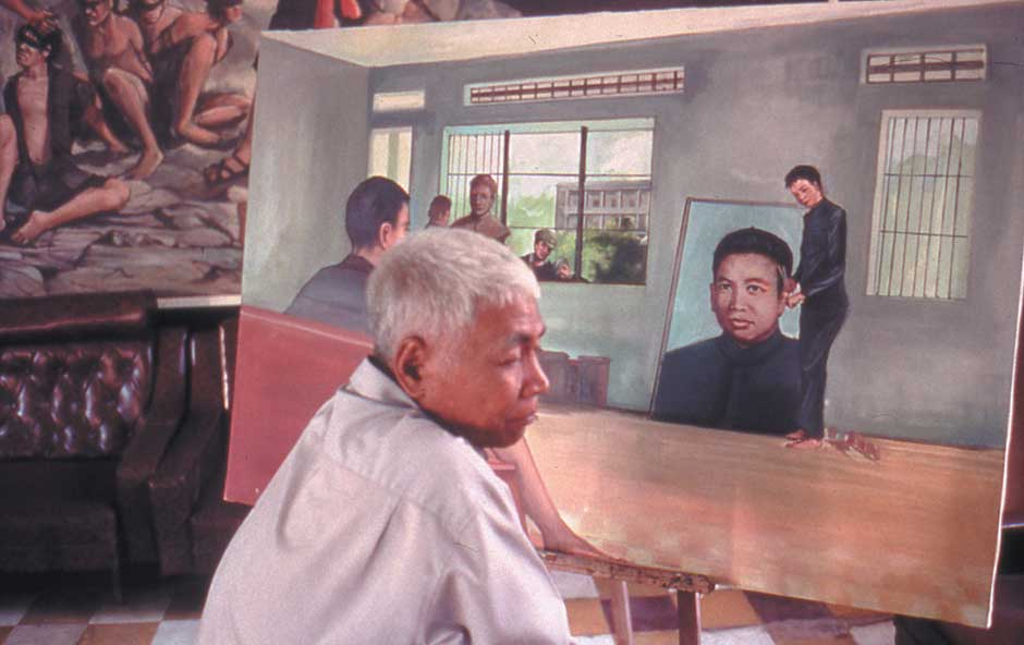 A scene from Rithy Panh's film S21: The Khmer Rouge Killing Machine showing the painter Vann Nath, one of the survivors of the Tuol Sleng prison