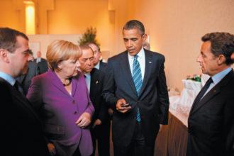 President Barack Obama showing his Blackberry to Russian President Dmitry Medvedev, German Chancellor Angela Merkel, Italian Prime Minister Silvio Berlusconi, and French President Nicolas Sarkozy at the G8 Summit, Huntsville, Ontario, June 2010