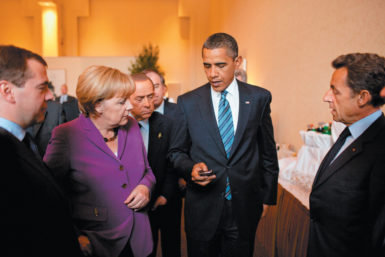 President Barack Obama showing his Blackberry to Russian President Dmitry Medvedev, German Chancellor ­Angela Merkel, Italian Prime Minister Silvio Berlusconi, and French President Nicolas Sarkozy at the G8 Summit, Huntsville, Ontario, June 2010