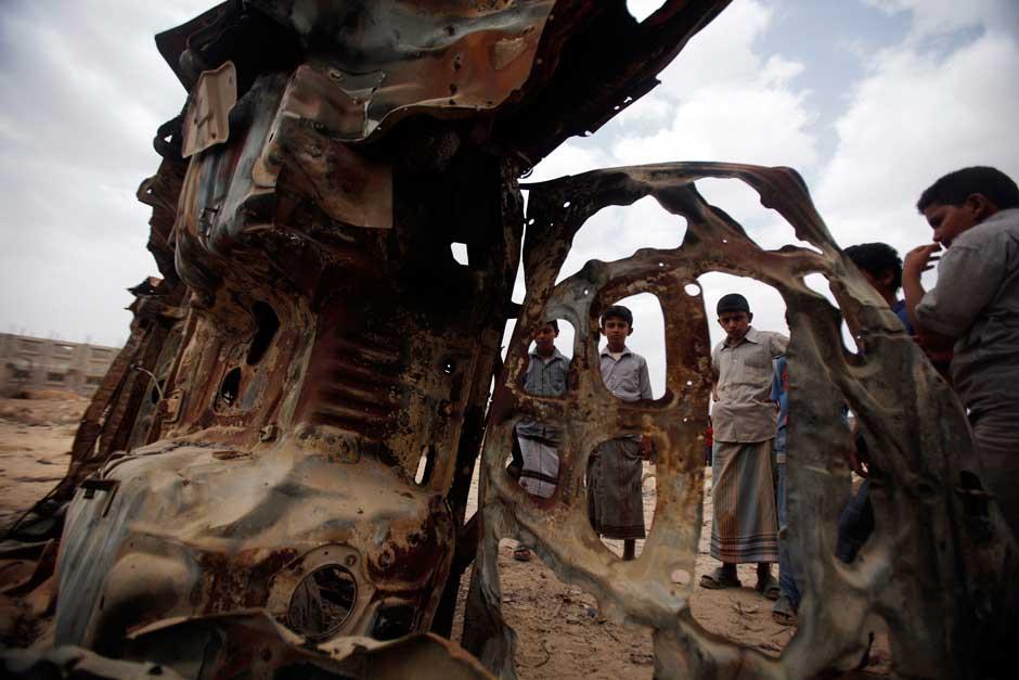 Boys gathering near the wreckage.jpg
