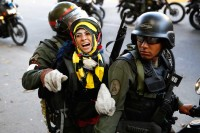 Venezuelan security forces detaining a protester, Caracas, March 16, 2014