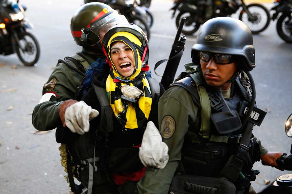 National guards transport an anti-government protester.jpg