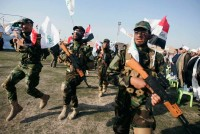 Members of Asaib Ahl al Haq, a Shiite militia, in Karbala, Iraq, March 21, 2014