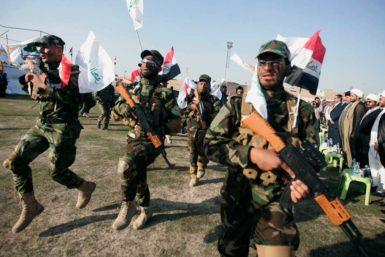Members of Asaib Ahl al Haq, a Shiite militia, in Karbala, Iraq, March 21, 2014
