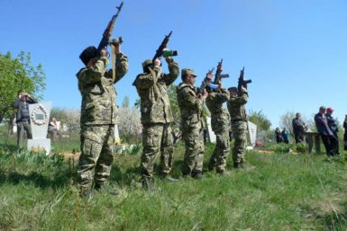 A rebel salute at the funeral of Aleksandr Lubenets, presumably killed by Ukrainian forces, Khrestysche, eastern Ukraine, April 2014