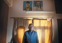Dina Nath Batra, the retired headmaster whose lawsuit against Penguin India led the company to agree to destroy copies of Wendy Doniger's book <i>The Hindus: An Alternative History</i>, in his office beneath portraits of right-wing Hindu nationalists K.B. Hedgewar and M.S. Golwakar, Delhi, February 2014