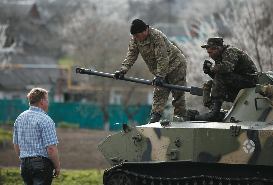 A pro-Russian protester talking to Ukrainian soldiers, whose convoy was halted by a pro-Russian crowd, Kramatorsk, eastern Ukraine, April 16, 2014