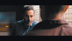Rami (Waleed Zuaiter), an Israeli intelligence agent, interrogating a young Palestinian named Omar (Adam Bakri)  in Hany Abu-Assad's film <i>Omar</i>