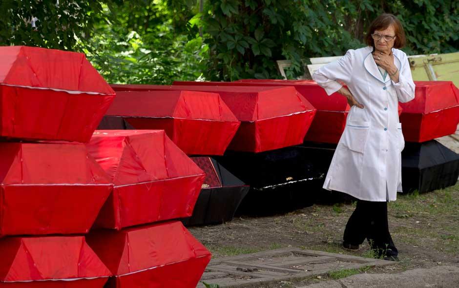 Woman looking at coffins.jpg