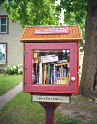 The first Little Free Library, inviting visitors to 'take a book, leave a book,' Hudson, Wisconsin, 2012; photograph by Robert Dawson from his book The Public Library: A Photographic Essay, just published by Princeton Architectural Press