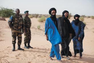 Malian soldiers with Tuareg men in the village of Tashek, near Timbuktu, July 2013