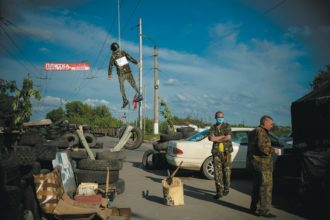 An effigy of the Kiev authorities hanging above a barricade, Sloviansk, eastern Ukraine, May 11, 2014