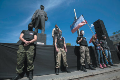 Pro-Russian activists in front of a statue of Lenin during a rally in Donetsk, eastern Ukraine, April 27, 2014
