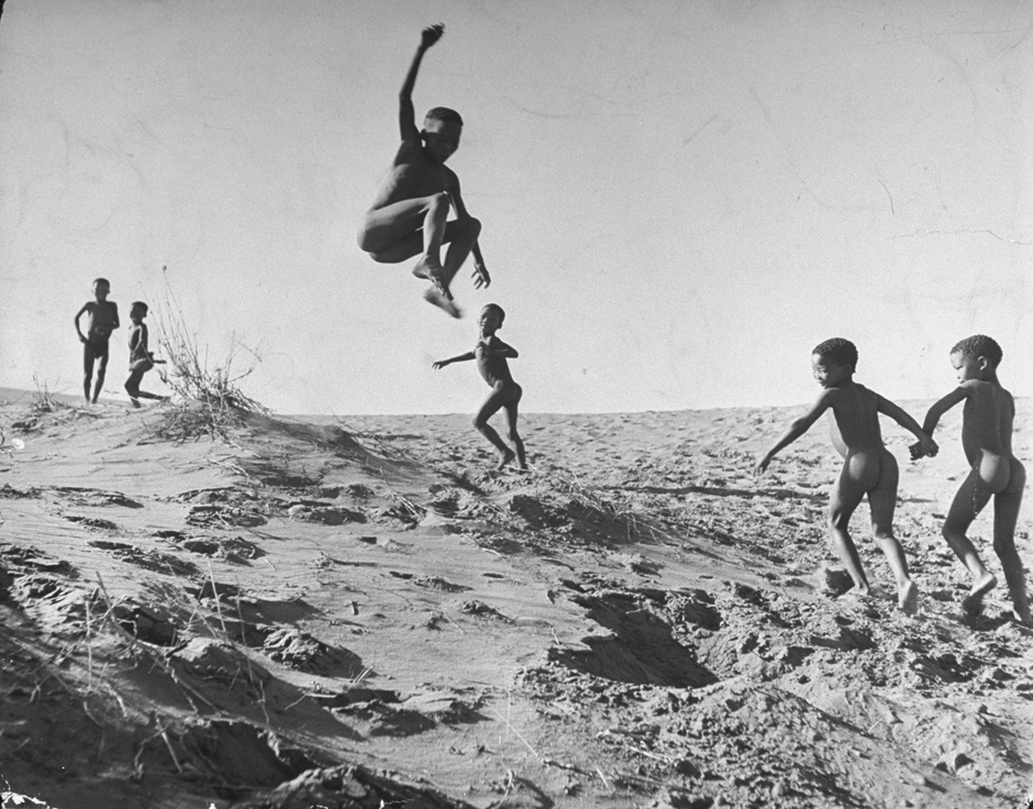 Bushman children playing games on sand dunes in the border area between Botswana and South Africa, 1947. The photograph appeared in the Museum of Modern Art's 'Family of Man' exhibition, organized by Edward Steichen in 1955.