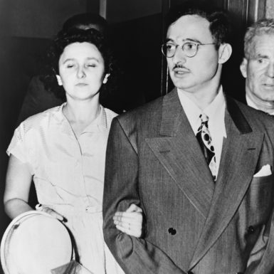 Ethel and Julius Rosenberg leaving the Southern District Court in Manhattan after they were charged with conspiracy to commit espionage, August 1950
