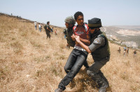 Israeli border guards detaining a Palestinian during clashes between Palestinians and Israeli settlers, after the settlers had allegedly set fire to fields near the village of Asira al-Qibliya, West Bank, June 2, 2010