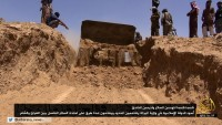 An image posted by ISIS of a bulldozer destroying a section of the Iraq-Syria border, June 2014