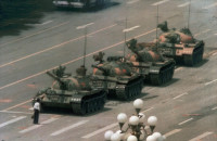 A Chinese citizen now known as Tank Man, blocking a line of tanks heading east on Chang'an Avenue, Tiananmen Square, Beijing, June 5, 1989