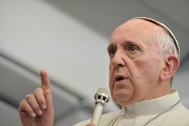 Pope Francis addressing journalists on the papal plane during a return flight to Italy from Brazil, July 28, 2013