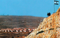Israeli soldiers on a hill overlooking an Israeli settlement in Ofra, the West Bank, 2001