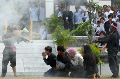 Cambodian students performing a reenactment of a Khmer Rouge massacre as part of the annual day of remembrance, Phnom Penh, May 20, 2014
