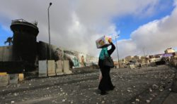A street littered with stones at the Qalandiya checkpoint north of Jerusalem, a day after Israeli soldiers fired on a large West Bank protest march there, July 25, 2014