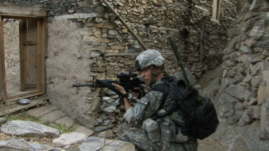 A soldier on patrol in Sebastian Junger's Korengal