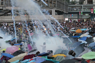 Tear gas canisters raining on thousands of pro-democracy protesters in Hong Kong, September 28, 2014