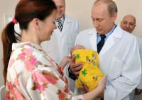 Russian President Vladimir Putin holding a newborn baby, Kaliningrad, Russia, 2011