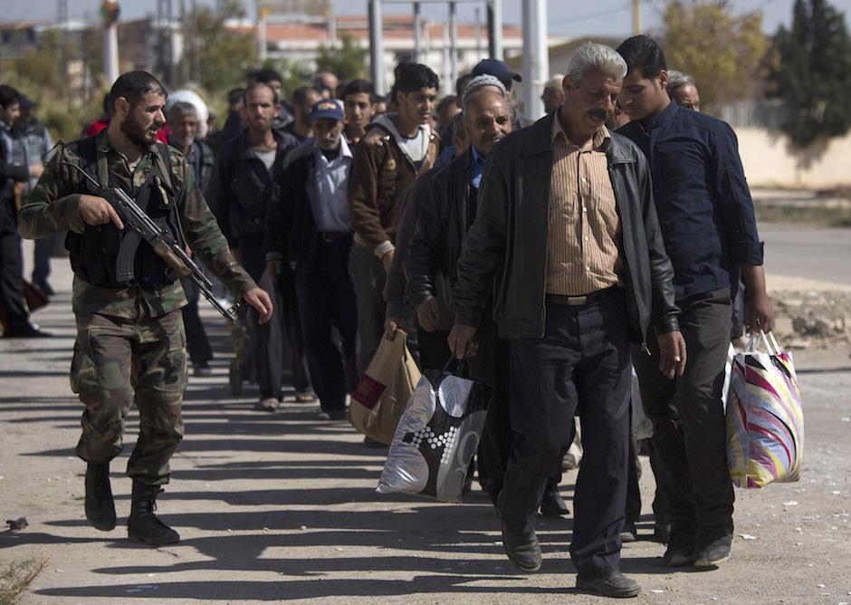 Syria soldier escort.jpg
