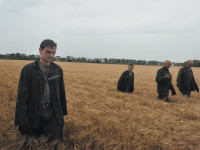 Rescuers searching for bodies at the crash site of flight MH17, eastern Ukraine, July 18, 2014