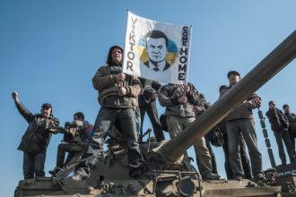Pro-Russian demonstrators in Donetsk, with a sign showing the ousted Ukrainian president, Viktor Yanukovych, who was born in the province of Donetsk and had been its governor prior to his presidency, March 30, 2014