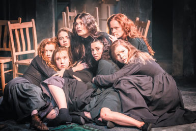 Samantha Colley (top center) as Abigail Williams in Yaël Farber's production of The Crucible