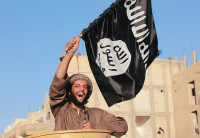 A militant Islamist fighter during a parade to celebrate the Islamic State's declaration of a caliphate, Raqqa province, Syria, June 30, 2014
