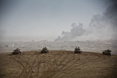 Turkish tanks standing by on the Syrian border with the battle of Kobani in the background, October 11, 2014