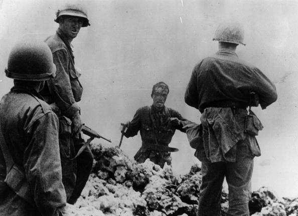 A Japanese naval lieutenant surrounded by American soldiers in Okinawa, July 14, 1945