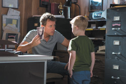 Greg Kinnear as Todd Burpo and Connor Corum as his son Colton in <i>Heaven Is for Real</i>, the film adaptation of Burpo's memoir about his son's near-death experience