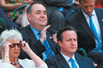 Scottish First Minister Alex Salmond (center), British Prime Minister David Cameron, and Cameron's mother, Mary, at the Wimbledon tennis championships, London, July 2013