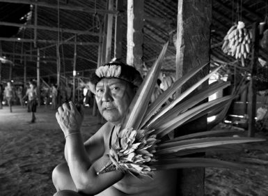 Shaman Davi Kopenawa in the Yanomami village of Demini, settled in the late 1970s near a FUNAI outpost that occupied a barracks from the abandoned Perimetral Norte road project, Yanomami territory, Roraima state, Brazil, April 2014; photographs by Sebastião Salgado, whose exhibition 'Sebastião Salgado: Genesis' is at the International Center of Photography, New York City, until January 11, 2015. The catalog is edited by Lélia Wanick Salgado and published by Taschen.