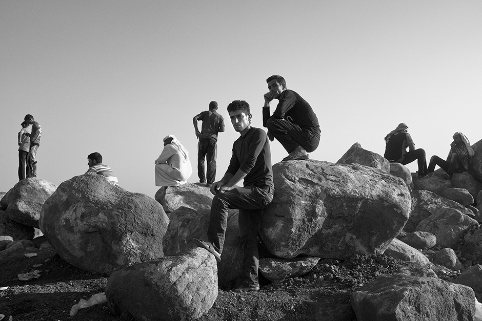 Yazidi men from Sinjar, northern Iraq, at a makeshift camp on the outskirts of the Kurdish-controlled town of Derek, Syria, after fleeing Islamic State militants, August 2014