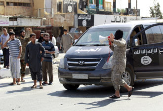 An ISIS official announcing the capture of Tabqa air base to residents of Raqqa province, Syria, August 24, 2014