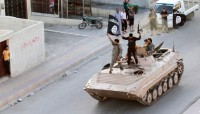 ISIS fighters in a military parade in northern Raqqa province, Syria, June 30, 2014