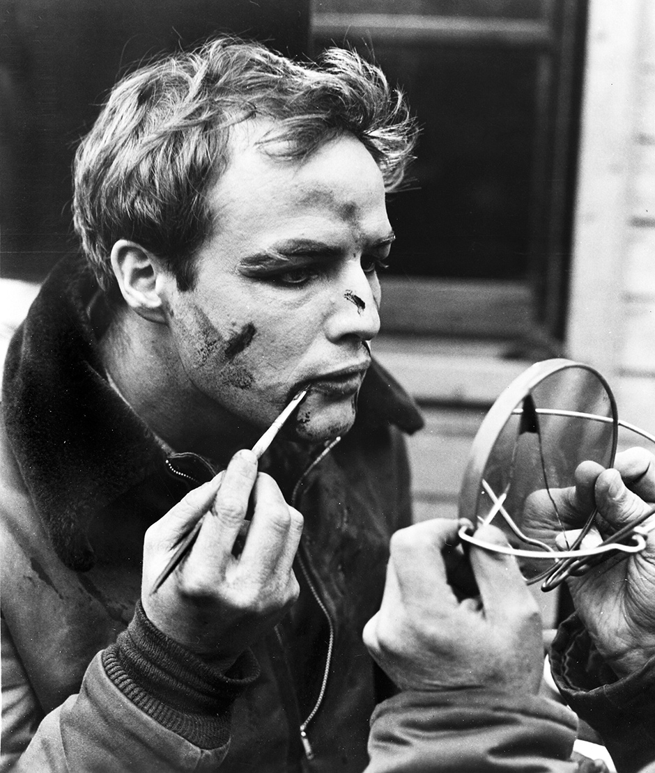 Marlon Brando applying bloody makeup for his role as Terry Malloy in On the Waterfront, 1954