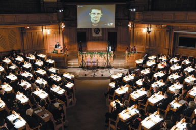 Edward Snowden, shown on a livestream from Moscow, receiving the Right Livelihood Honorary Award for 'his courage and skill in revealing the unprecedented extent of state surveillance violating basic democratic processes and human rights,' Swedish Parliament, Stockholm, December 2014