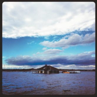 A house swept into a lake by the storm surge of Hurricane Sandy, Mantoloking, New Jersey, October 2012; photograph by Andrew Quilty from #Sandy: Seen Through the iPhones of Acclaimed Photographers, just published by Daylight