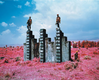 Richard Mosse: Triumph of the Will, 2011; infrared photograph of Congolese soldiers standing on a Belgian commando training structure at Rumangabo military base, North Kivu, eastern Congo
